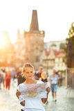 Pretty young female tourist studying a map Royalty Free Stock Photos
