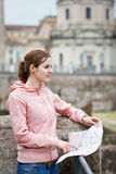 Pretty young female tourist studying a map at the Trajan's forum Stock Photos