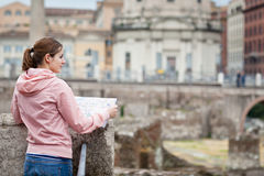 Pretty young female tourist studying a map at the Trajan's forum Stock Images