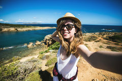 Pretty young female tourist takes travel selfie at Royalty Free Stock Photo
