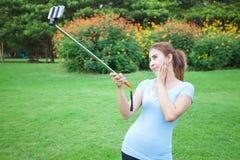 Pretty young female tourist takes travel selfie Stock Photos