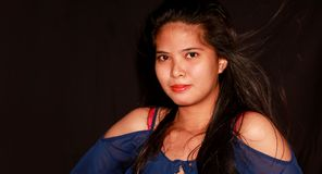 Pretty young Filipina looking through the camera. Studion shot l portraiture Royalty Free Stock Image