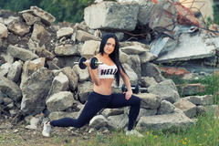 Pretty young fitness girl working out Stock Image
