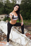 Pretty young fitness girl working out Royalty Free Stock Photos