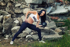 Pretty young fitness girl working out Royalty Free Stock Image