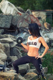 Pretty young fitness girl working out Stock Images
