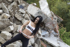 Pretty young fitness girl working out Royalty Free Stock Images