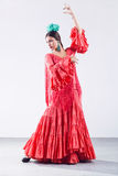 Pretty young flamenco dancer in beautiful dress. Stock Images