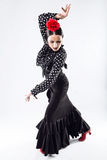 Pretty young flamenco dancer in beautiful dress. Royalty Free Stock Images
