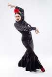 Pretty young flamenco dancer in beautiful dress. Stock Photo