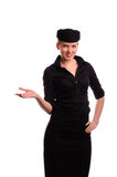Pretty young flight attendant. Beautiful young flight attendant in black clothing, isolated on white Stock Photos
