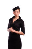 Pretty young flight attendant. Beautiful young flight attendant in black clothing, isolated on white Royalty Free Stock Photo