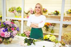 Pretty young florist Royalty Free Stock Photography