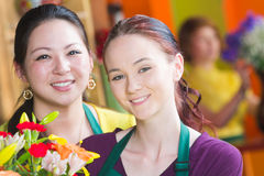 Pretty Young Flower Shop Employees Royalty Free Stock Photography