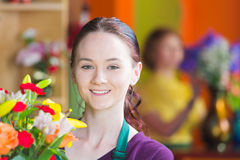Pretty Young Flower Shop Worker Royalty Free Stock Photo