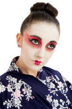 Pretty young Geisha girl. Image showing pretty young geisha girl isolated against white Stock Photography
