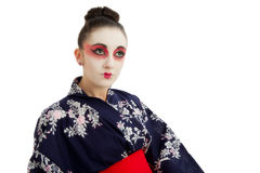Pretty young Geisha girl. Image showing pretty young geisha girl isolated against white Royalty Free Stock Images