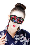 Pretty young Geisha girl. Image showing pretty young geisha girl with colourful mask Royalty Free Stock Photos