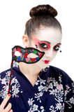 Pretty young Geisha girl. Image showing pretty young geisha girl with colourful mask Royalty Free Stock Image