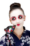 Pretty young Geisha girl. Image showing pretty young geisha girl with colourful mask Royalty Free Stock Photography