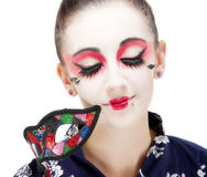 Pretty young Geisha girl. Image showing pretty young geisha girl with mask Royalty Free Stock Images