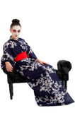 Pretty young Geisha girl relaxing. Image showing pretty young geisha girl isolated against white Royalty Free Stock Images