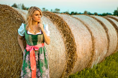Pretty young german oktoberfest blonde woman wearing a dirndl Royalty Free Stock Images