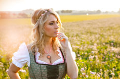 Pretty young german oktoberfest blonde woman wearing a dirndl Royalty Free Stock Image