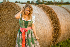 Pretty young german oktoberfest blonde woman wearing a dirndll Royalty Free Stock Photos