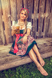 Pretty young german oktoberfest woman in a dirndl dress w Royalty Free Stock Images