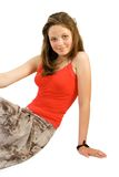 Pretty young girl. Sets upon floor. Isolate on white Royalty Free Stock Photos
