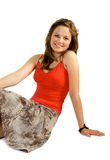 Pretty young girl. Sets upon floor. Isolate on white Stock Photo