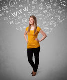 Pretty young girl with abstract white media icon doodles Royalty Free Stock Photo