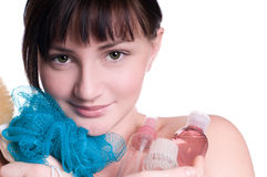 Pretty young girl with accessories for shower isol Stock Photos