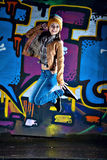 Pretty Young Girl And Graffiti Royalty Free Stock Photography