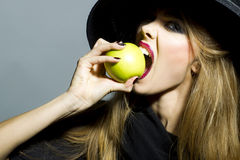 Pretty young girl with apple Royalty Free Stock Photos
