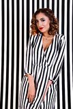 Girl at the background of black and white stripes Stock Photography