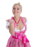 Pretty young girl in bavarian dirndl isolated give a kiss with h Royalty Free Stock Photo
