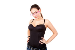 Pretty young girl in black corset with glasses Stock Image