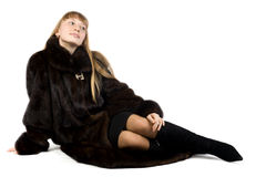 Pretty young girl in black fur jacket Stock Photos
