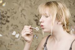 Pretty young girl blowing bubbles Royalty Free Stock Photography