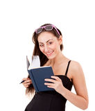 Pretty young girl with book, pen and glasses Royalty Free Stock Photo