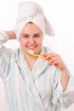 Pretty young girl brushes her white teeth Royalty Free Stock Image