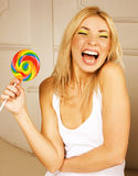 Pretty young girl with candy Royalty Free Stock Photography