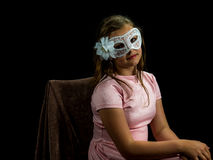 Pretty young girl in the carnival mask closeup Stock Image