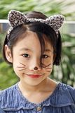Pretty young girl with cat face paint stock photos