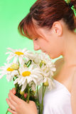 Pretty young girl with chamomile flowers Royalty Free Stock Photo