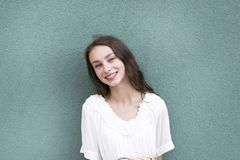 Pretty young girl with charming smile stock images
