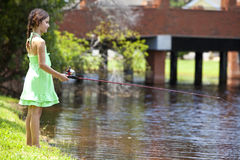 Pretty Young Girl Child Fishing On A RIver Stock Image