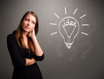 Young girl comming up with a light bubl idea sign Royalty Free Stock Image